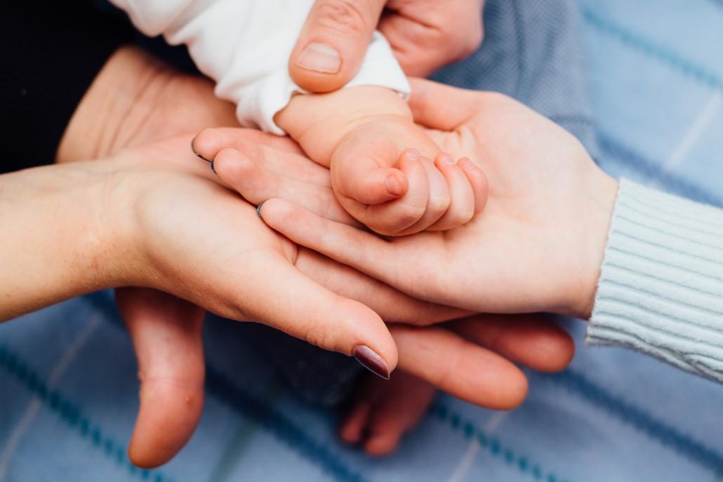 Family keeps hands together